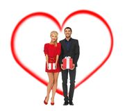 Smiling man and woman with gift boxes Stock Images
