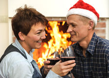 Smiling man and woman with glasses of wine Stock Image
