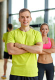 Smiling man and woman in gym Royalty Free Stock Photo