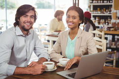 Smiling man and woman having cup of coffee Royalty Free Stock Photo
