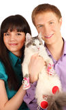 Smiling man and woman hold cat. Smiling young men and women hold cat wearing in red boots isolated on white background Stock Images