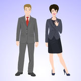 Smiling man and woman in office style wear Royalty Free Stock Images