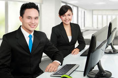 Smiling man and woman office worker Stock Images