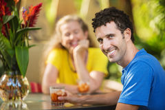 Smiling Man with Woman Outdoors Royalty Free Stock Photography