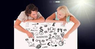 Smiling man and woman pointing at business graphics on bill board Stock Images