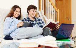 Smiling man and woman preparing for exams Stock Images