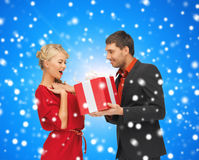 Smiling man and woman with present Stock Photos