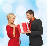 Smiling man and woman with present Royalty Free Stock Image