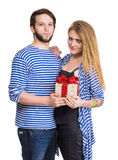 Smiling man and woman with present Stock Photography