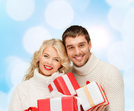 Smiling man and woman with presents Stock Photo