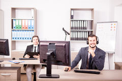 Smiling man working at Customer service support in the office Stock Photo