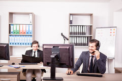 Smiling man working at Customer service support in the office Stock Image