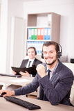 Smiling man working at Customer service support in the office Royalty Free Stock Images