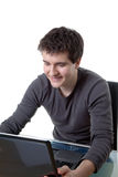 A smiling man working with a laptop Royalty Free Stock Photography