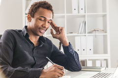 Smiling man working on project Royalty Free Stock Image