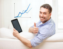 Smiling man working with tablet pc at home Stock Photos