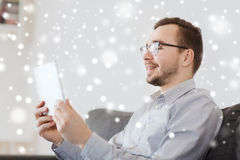 Smiling man working with tablet pc at home Royalty Free Stock Photo