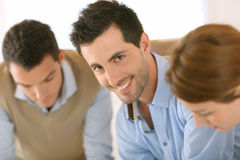 Smiling man working with workteam Royalty Free Stock Photo