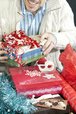 Smiling Man Wrapping Presents Stock Photography