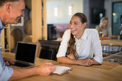 Smiling manager and bartender interacting with each other. In bar Stock Images