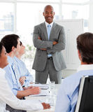 Smiling manager doing a presentation. To his team Stock Photos