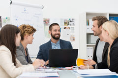 Smiling manager with his business team Royalty Free Stock Photography