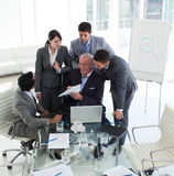Smiling manager with his team in a meeting Royalty Free Stock Images