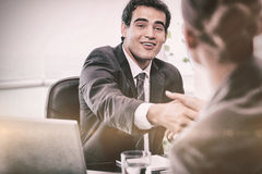 Smiling manager interviewing a female applicant. In his office Royalty Free Stock Photos