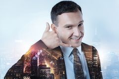 Smiling manager keeping his hand near ear Royalty Free Stock Photo