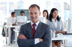 Smiling manager leading his team royalty free stock photography