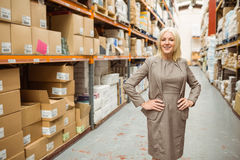 Smiling manager placing her hands on her hips Stock Photos