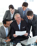 Smiling manager pointing at a contract Stock Image