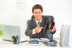 Smiling manager pointing on mobile Stock Photos