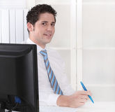 Smiling manager sitting at office - positive. Royalty Free Stock Photography