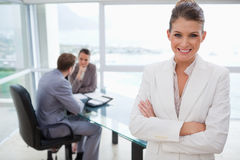 Smiling manager standing in conference room Stock Photos