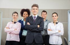 Smiling Manager And Team Standing At Call Center. Portrait of smiling manager and team standing arms crossed at call center Royalty Free Stock Photography