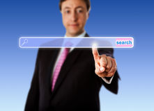 Smiling Manager Touching An Empty Search Bar Royalty Free Stock Photos
