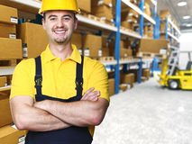 Smiling manual worker. Isolated warehouse 3d  background Stock Images