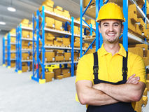 Smiling manual worker. Isolated warehouse 3d  background Stock Image