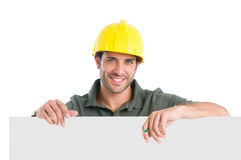 Smiling manual worker. Happy manual worker presenting your text isolated on white background Stock Photos