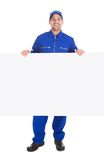 Smiling manual worker with billboard Stock Photography