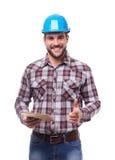 Smiling manual worker in blue helmet with digital tablet Stock Photo