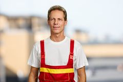 Smiling manual worker on blurred background. Stock Photos