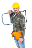 Smiling manual worker carrying step ladder. On white background Royalty Free Stock Photography