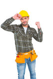 Smiling manual worker clenching fist Royalty Free Stock Photos