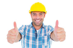 Smiling manual worker gesturing thumbs up Stock Photography