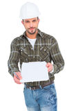 Smiling manual worker giving clipboard for signature Stock Photos