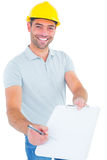 Smiling manual worker giving clipboard for signature Royalty Free Stock Photos