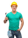 Smiling manual worker in helmet with hammer Royalty Free Stock Photo