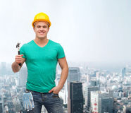 Smiling manual worker in helmet with hammer Stock Images